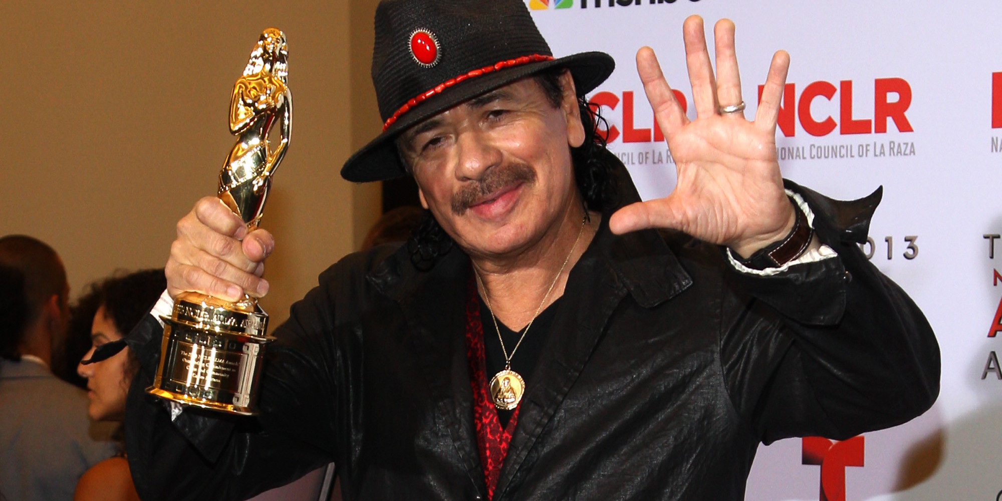 Carlos Santana poses backstage with the award for outstanding commitment to cause and community: male at the NCLR ALMA Awards at the Pasadena Civic Auditorium on Friday, Sept. 27, 2013, in Pasadena, Calif. (Photo by Paul Hebert/Invision/AP Images)